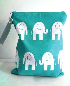 Elephant Wet Bag Large Aqua Marine by LilTotWonder on Etsy, $19.00 - They have a ton of adorable bags, in wonderful prints!