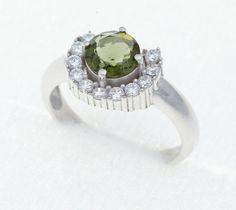Stříbrný prsten s broušeným jihočeským vltavínem a zirkony. Velikost vltavínu: 7 mm Velikost prstenu: 54 Hmotnost šperku: 3,72 g Materiál: Stříbro 925/1000, rhodiovaný povrch zabraňující oxidaci a černání. Engagement Rings, Jewelry, Enagement Rings, Wedding Rings, Jewlery, Jewerly, Schmuck, Jewels, Jewelery