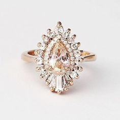 Rhapsody The Rhapsody with peach sapphire by Heidi Gibson.The Rhapsody with peach sapphire by Heidi Gibson. Engagement Ring Settings, Vintage Engagement Rings, Vintage Rings, Halo Engagement, Vintage Necklaces, Jewelry Rings, Fine Jewelry, Peach Sapphire, Diy Schmuck
