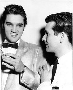 """On Thanksgiving Day, November 22nd, of 1956,  Elvis, Scotty, Bill and DJ made their only (2) appearance(s) together in Toledo on the first stop of a 4 day tour that also included  Cleveland and Troy, Ohio and then Louisville. Elvis is pictured in between shows (1 matinee at 2:30 p.m. and 1 evening at 8:00 p.m.) backstage wearing the Gold """"Satiny"""" coat at the Toledo Sports Arena, Toledo, OH,  Thursday, November 22, 1956."""