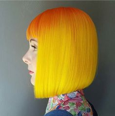 Conventional meets unconventional with this classic bob in orange to golden yellow ombre.