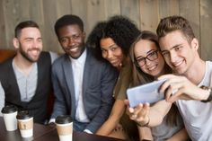 Young caucasian man making selfie on smartphone at meeting with multiracial millennial friends, diverse happy people having fun in cafe together taking group self-portrait photo on mobile phone People Having Fun, Happy People, Portrait Photo, Ux Design, Royalty Free Photos, Have Fun, Smartphone, Clip Art, Selfie