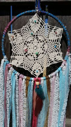 Check out this item in my Etsy shop https://www.etsy.com/listing/243277532/gypsy-boho-lace-doily-dreamcatcher