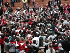 An impromptu group hug by students and staff in the gym on the day of return.