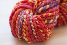 Items similar to Handspun soft superfine merino yarn / Brilliant reds oranges yellows and violet / Bulky - Super Bulky weight handspun soft merino yarn on Etsy Hand Spinning, My Etsy Shop, Trending Outfits, Knitting, Unique Jewelry, Handmade Gifts, Yarns, Accessories, Vintage