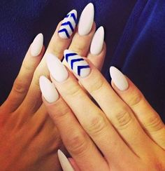 White almond nails with bleu stripes on two fingers
