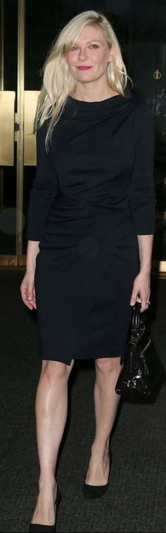 Kirsten Dunst in Salvatore Ferragamo Wool Jersey Wrap Dress and handbag - New York
