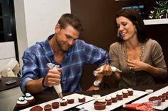 Chicago Cubs' Kerry and Sarah Wood decorate cupcakes at Swirlz Cupcake