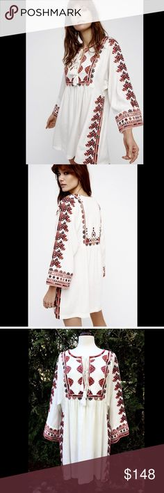 "Free People ivory red Embroidered Babydoll Dress L Free People ivory red Embroidered Babydoll Tassel Swing Dolman Sleeve Tunic Dress multi colored embroidered babydoll weighty drapy mini tunic dress   featured a center cutout with adjustable tassel ties  effortless shape with wide dolman sleeves New With Tags  *  Size:  Large retail price:  $168.00  75% rayon * 25% linen   39"" around waist 33"" long Free People Dresses"