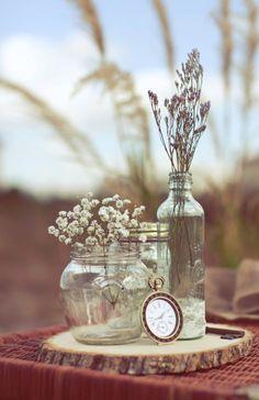 rustic wood log slice and simple elegant crystal vase centerpiece