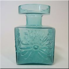 Dartington British turquoise green glass 'stylised flower' vase, designed by Frank Thrower, pattern number FT60.