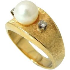 Gorgeous vintage Cultured Pearl ring has an abundance of 14k yellow gold on the band with a satin texture finish and boasts the most lustrous 7mm white pearl. There are two raised individually set dia