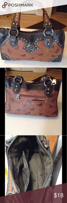 Montana west handbag Great Montana West handbag in excellent condition. It has a beautiful horse motif on the outside. It is approximately 9 inches high 14 inches wide and 5 inches deep all of the hardware and studs are there. I am selling it because I have way too many handbags and never seem to use this one montana west Bags Satchels