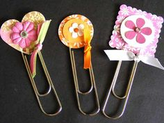 Bookmarks- using paperclips & buttons, ribbon, and whatever else is hanging around.