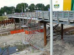 A close up view on the temporary metal bridge over the excavation for the new metro tunnel, with sheet piling and concrete wire constructions, in Amsterdam city, district North; urban photography in the Netherlands, Fons Heijnsbroek, 2007