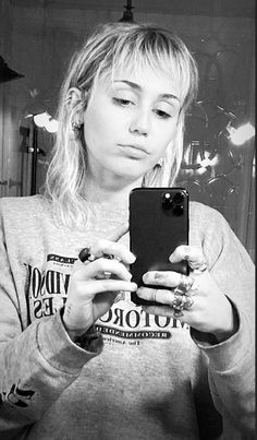 While teasing new music for Miley Cyrus also showed off her new hair. Taking a few inches off her textured mullet, Cyrus posed on the floor in jeans, a t-shirt and cat eye sunglasses. Miley Cyrus Hair, Miley Cyrus Style, Miley Cyrus Instagram, Modern Mullet, Short Mullet, Mullet Hairstyle, Mullet Haircut, Mullets, Girl Short Hair