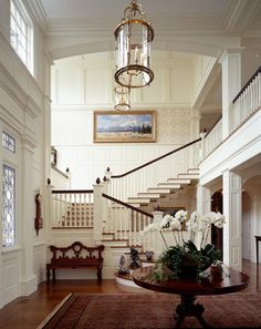 Entryway Staircase with Traditional White Wood Wall Panels and Moldings - Brittfurn Stockholm