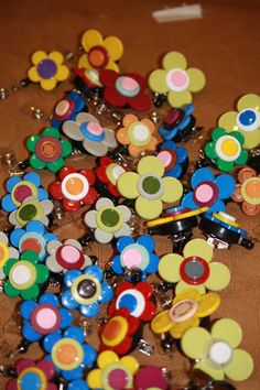 Retractable badge holders made with flip off vial caps! So Cute!