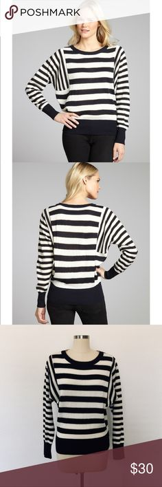 "ELLEN TRACY Striped Dolman Wool Blend Sweater ELLEN TRACY Pullover Striped Dolman sweater. Navy and Cream Wool Blend. Long sleeves, with ribbed knit trim. Medium. Elegant 1% metallic gold pinstripe detail. Excellent condition. Armpit to armpit: 20'' Length: 25"". Ellen Tracy Sweaters"