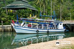 boat in chai chet, koh chang, thailand