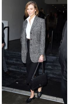 She may not work in a traditional office setting, but Karlie Kloss is still doing 9-to-5 wear better than all of us. Is that even fair? Regardless, the model looked sleek and chic at New York Fashion Week in a long, tailored blazer, a button-down blouse, and high-waisted trousers.