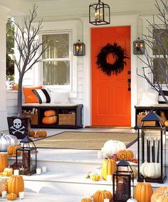 fall-porch-decorating-ideas LOVE that ORange door! if my house was a different color.we'd have an orange door! matches the school colors too! Halloween Veranda, Casa Halloween, Holidays Halloween, Outdoor Halloween, Happy Halloween, Halloween Halloween, Halloween Images, Vintage Halloween, Halloween Clothes