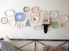 An eclectic mix of #vintage plates is an easy, inexpensive way to decorate a bedroom wall in a little girl's bedroom