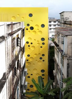 Stairwell resembling a giant swiss cheese wedge by Spark, Bangkok youth center
