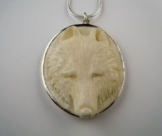 Carved Wolf Head Set in Sterling Pendant