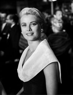 Grace Kelly. Nice straight-forward shot, the sort that relieves you of the tedium of a contrived image.