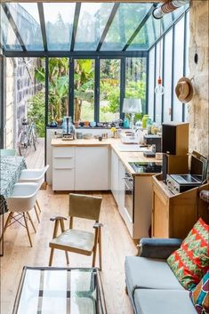 Bringing the outside in with this green modern and cosy kitchen. Cosy Kitchen, Kitchen Lamps, Kitchen Interior, Kitchen Decor, Kitchen Design, Kitchen Backsplash, Kitchen Ideas, Kitchen Cabinets, Design Room