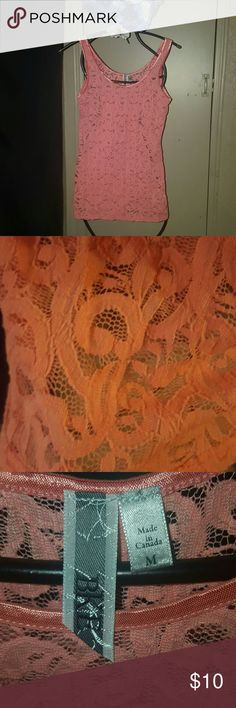 Coral Lace Top Pretty coral lace overlay top. Trim is shiny coral color. Gently used. Could fit a small or extra small as well. BKE Tops Tank Tops