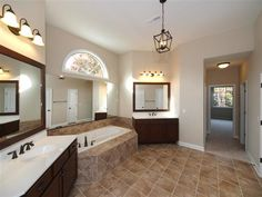 Luxurious Spa Bathroom with Dual Vanities, Garden Tub and Tiled Shower in the Manning at BridgeMill, Homesite 411