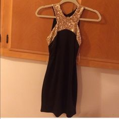 Black and gold dress Great condition. No fading! Super cute LBD ! WINDSOR Dresses Mini