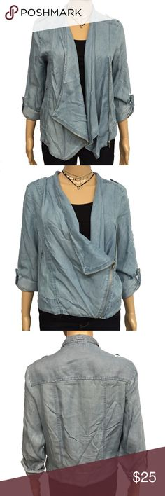 Denim Asymmetrical Moto Jacket This is a super cool light wash denim Moto style jacket. There are two zippered pockets, shoulder epaulets, and roll tab sleeves. It's lightweight and perfect for cool fall days. New with tags, never worn. Runs true to size. Cotton Express Jackets & Coats Jean Jackets