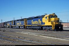 In June 1972, the Santa Fe debuted the first two locomotives in the new Yellow Warbonnet paint scheme: SD45 5524 (painted in the shops at San Bernardino, CA) and U28CG 7904 (painted in Argentine Shops in Kansas City, KS). Designed to increase locomotive visibility at grade crossings, the scheme was quickly applied to older locomotives and, of course, all new power delivered from that point on. (I suspect the railroad also wanted to retain their iconic Warbonnet design, which was going to…