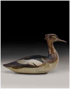 A rare red-breasted Merganser Hen bird decoy by carver Lothrop Holmes (1821 - 1899)