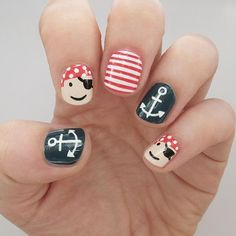 Take nautical nails to a whole new level with this sea-worthy look that combines anchors, stripes and cartoon pirates for a mani that's worth its weight in gold.