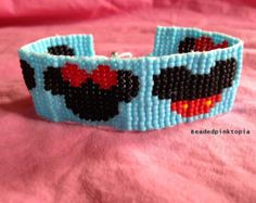 Disney's Mickey and Minnie Mouse bracelet Bracelet has 2 Minnie and 2 Mickey ears with a light blue background. Bracelet is made with Toho bracelet. Beaded Earrings Native, Beaded Cuff Bracelet, Bead Loom Bracelets, Beaded Bracelet Patterns, Bead Loom Patterns, Jewelry Patterns, Beaded Crafts, Handmade Beaded Jewelry, Friendship Bracelets Designs