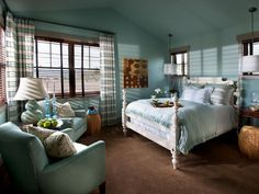 "Dubbed ""the serenity room,"" the first-floor bedroom provides a quiet retreat for overnight guests. Walls clad in a robin's-egg blue reinforce a design scheme inspired by the home's location."