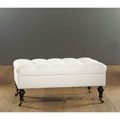 Anyone know where I can find an ottoman/coffee table like this (this one from Ballard Designs) but in leather? I'm looking for rectangle, dark brown leather, tufted, turned legs. Storage is optional.