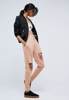 """Calling all taller ballers. Shop our missguided tall range, for babes 5""""7 and over. Nail the casual look with these pink ripped joggers with pockets and adjustment cord."""
