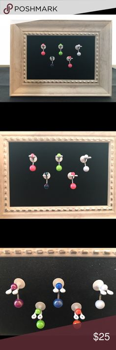 """Navel Ring display that will organize body jewelry Decorative white 5x7"""" tabletop frame with design, black velvet sparkle background and 5 Nabel holders. 1 acrylic navel ring is included for Free with purchase of body jewelry display. Navel-Novelties Accessories"""