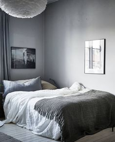 What a soothing grey bedroom, we love the simple use of black and white photography on the walls to bring the colours together.
