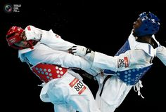 Day 15 - Gabon's Obame kicks Italy's Molfetta in the face as they compete in their men's +80kg gold medal taekwondo final at the ExCel venue during the London 2012 Olympic Games. KIM KYUNG-HOON/REUTERS