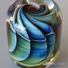 this is a beautiful lamp work bead by Badger Beads via Page Flippin