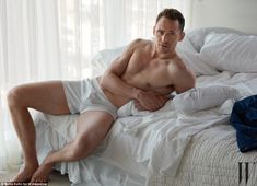Come-hither stare: The 35-year-old British actor can be seen posing on a rumpled bed in the playful editorial