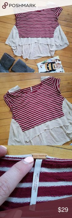 "Urban Outfitters Free People French Kiss T Urban Outfitters Free People French Kiss T A classic striped tee is transformed by a dreamy, semi-sheer back panel shaped by box pleats into a flowing high/low hem. Solid shoulder panels frame the eye-catching square back. Slips on over head. Crewneck. Short sleeves. High/low hem. 70% cotton, 30% polyester with 100% polyester back panel. Size M 21"" front length; 29"" back length Free People Tops Tees - Short Sleeve"