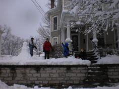 Neighbors and their snowman.