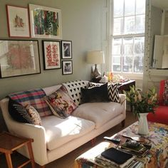 House & Garden's decoration editor Gabby Deeming chose Farrow & Ball 'Mizzle' for the walls of her Bloomsbury flat, while the pink sofa fabric is from Dominique Kieffer. The ottoman fabric is from Etro - not really into mishmash but visually this looks lived in, warm and welcoming.